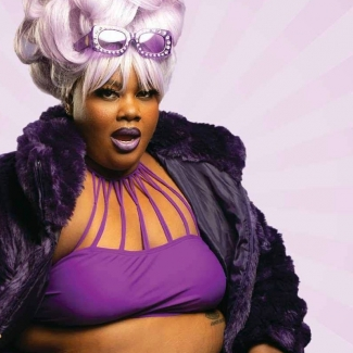 #VERYFAT #VERYBRAVE author Nicole Byer looking sassy in a purple bikini top and purple sunglasses on her head