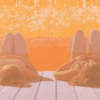 Two women lying on a deck