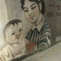 Street art of a woman and child